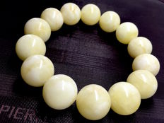 Amber bracelet, white/milky round shaped beads of 32.8 g