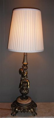 Brass table lamp with putti and pliché lampshade, mid 20th century