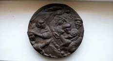 A very heavy iron relief plaque with a medieval depiction.