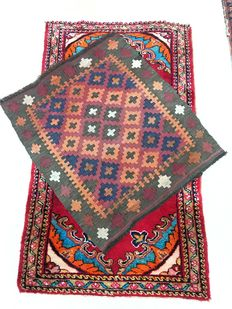 Lot of 2 small antique rugs.