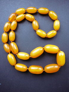 Necklace of pressed balic amber in egg yellow