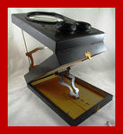 Siehe unsere Beautiful vintage wooden stereo viewer with magnifying glass from the early 1900s