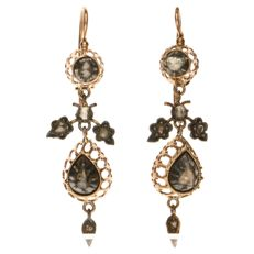 Rose gold dangle earrings, each set with 6 rose cut diamonds of approx. 0.21 ct in total