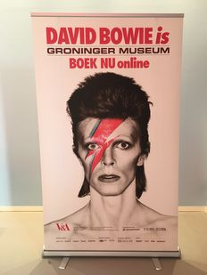 Exhibition banner for 'David Bowie is' with image of Alladin Sane