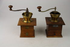 Two old wooden coffee grinders
