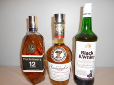 3 bottles of whisky .The Antiquary De Luxe 12 yo  75cl - 1  Old Smuggler Finest 75cl - 1 Black & white Buchanan's 75 cl