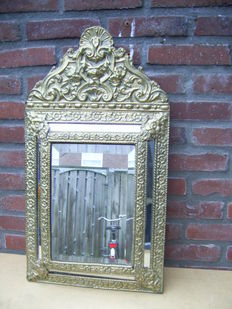 Antique mirror with copper fittings and cut centre mirror.