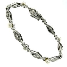 18k White gold Art Deco diamond and cultivated pearl bracelet from Italy, circa 1930