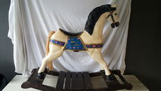 Old heavy solid wooden rocking horse