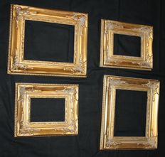 Four beautiful, gold-colored carved picture frames.