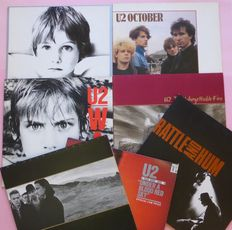 The fist 7 albums by U2; Boy, October, War, Live, The Unforgettable Fire, The Joshua Tree and Rattle and Hum (2), all VG+/VG+
