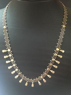 Gold droplet necklace of 14 kt from the 1950s/1960s