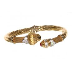 Rigid two-tone gold bracelet with zirconias and ruby