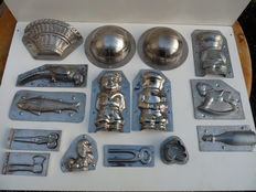 A lot of 15 antique confectioners chocolate moulds.