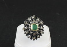 Ring in 14 kt rose gold and silver, with natural central emerald and diamonds, from the 1950s.