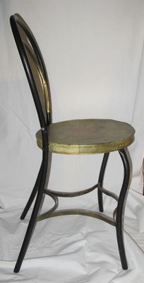 Decorated iron chair from the 30s