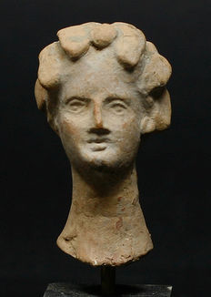 Hellenistic terracotta head of a woman - 49 mm