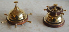 Collectible desk bells in brass and wood .