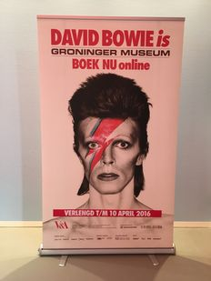 Exhibition banner for 'David Bowie is' with image of Alladin Sane and extended exhibition tekst
