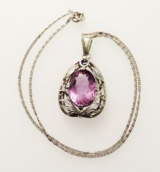 A massive 830 silver pendant with real amethyst (approx. 11.8 ct) & 835 silver necklace
