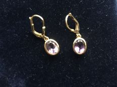 """Gold and sapphire """"drop"""" earrings."""