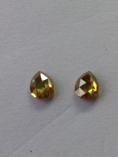Two rose cut, natural coloured diamonds of 0.53 carat in total