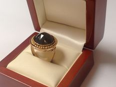 Gold 14 kt women's ring with facet cut round garnet from the 19th century.