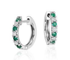 White gold earrings with emeralds and diamonds.