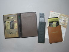 2 Duplex Addiator Maximators and 1 Addimult - calculators - with original leather case, stylus, and instructions for use