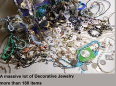 A massive lot of Decorative Jewelry with more than 180 items and collectibles.