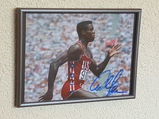 Carl Lewis - 8-times world champion and 9-times Olympic champion sprint and long jump - original autographed framed photo + COA