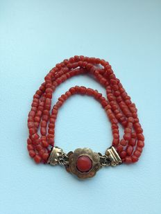 Red coral bracelet, 4-rowed, with  14 karat, gold clasp.