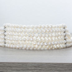 Choker necklace with 6 strands of pearls and sterling silver.