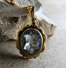 Gold pendant with natural aquamarine/beryl and gold necklace.