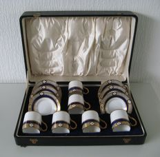 Beautiful old suitcase with six Royal Albert Mocha cups and saucers