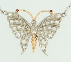 Platinum and gold necklace set with a centre piece in the shape of a butterfly set with ruby and rose cut diamonds.