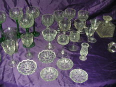 Collection of crystal and glass items from early and middle 20th century including glass (cut), vases, perfume bottles and miscellaneous items.