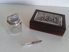 Silver Crystal lighter with silver cigarette holder and silver-plated tobacco box.