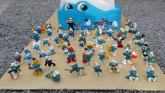 Collection of 52 Smurfs and toy chest