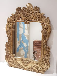 Large antique gilded mirror with representing cherubs framed with floral ornaments, 21st century