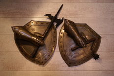2 shields with glove and weaponry