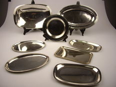 Set of silver colored metal plates