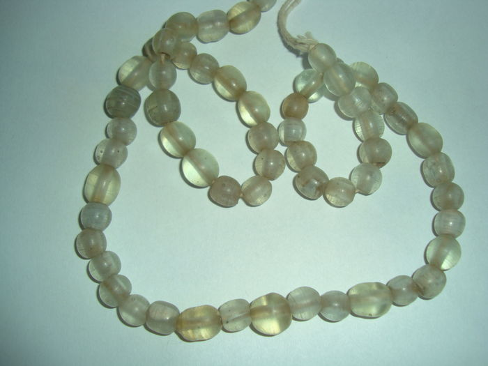 A lot of 57 archaic glass beads necklace - 440 mm