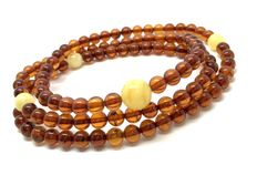 Tibetan Mala Necklace of natural Baltic amber 5.5-9.5 mm beads, cognac&butter (not pressed)