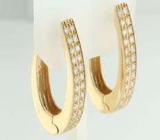 Yellow gold earrings of 18 kt with brilliant cut diamonds