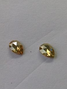 2 diamonds, 0.48 ct in total, natural intense colour, SI