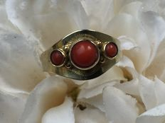 Gold ring with red coral