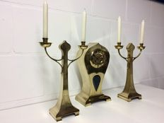 Brass Art Deco mantel clock with two matching candelabra