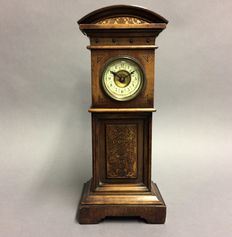 Miniature standing clock with alarm clock type as movement – period 1930