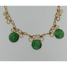 14 kt yellow gold vintage necklace with three round, jade pendants
